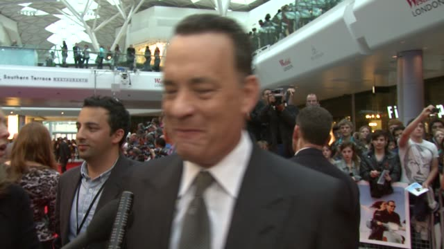 Tom Hanks on the premiere being in London having Julia Roberts on board working on set with her at the Larry Crowne World Premiere at London London