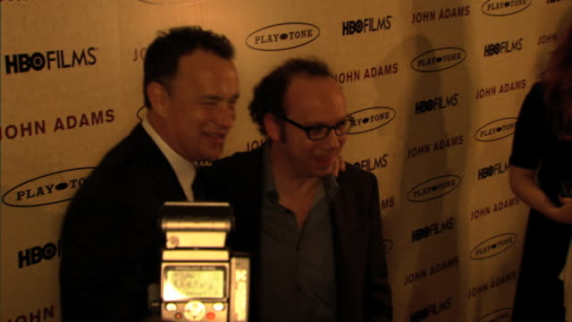Tom Hanks Paul Giamatti standing together on red carpet at Museum of Modern Art MoMA posing for press photographs
