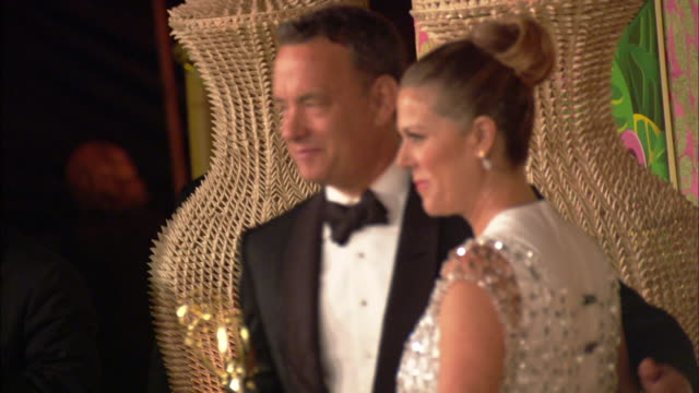 MS Tom Hanks posing with his Emmy and wife Rita Wilson on the red carpet at Pacific Design Center Los Angeles