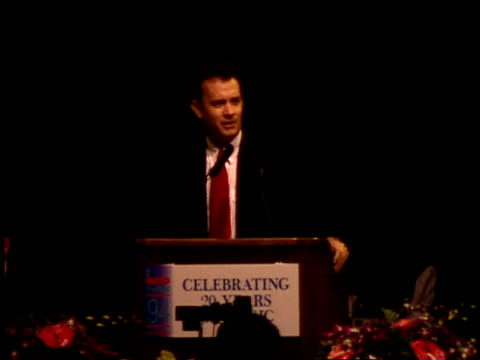Tom Hanks speaks on stage