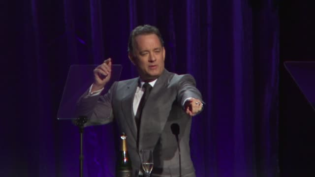 Tom Hanks talking about Christina Applegate at the An Unforgettable Evening Benefiting EIF's Women's Cancer Research Fund at Beverly Hills CA