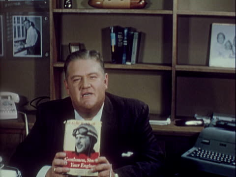 tom hanley seated at desk, holding copy of 'gentlemen, start your engines' by wilbur r. shaw, talking to camera. 'one particular sport, however, has... - 1960 stock videos & royalty-free footage