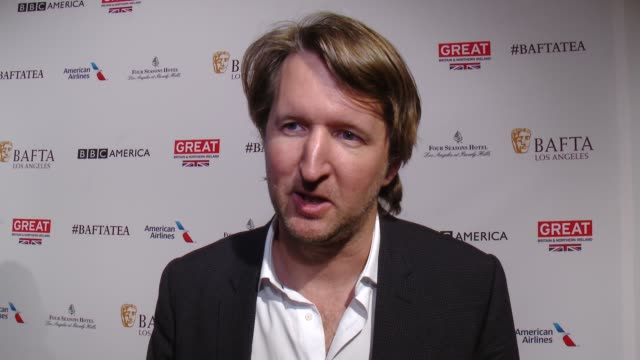 interview tom hooper on being at the event and on his hopes for eddie redmayne and alicia vikander at the golden globes at the bafta los angeles... - tea party stock videos and b-roll footage