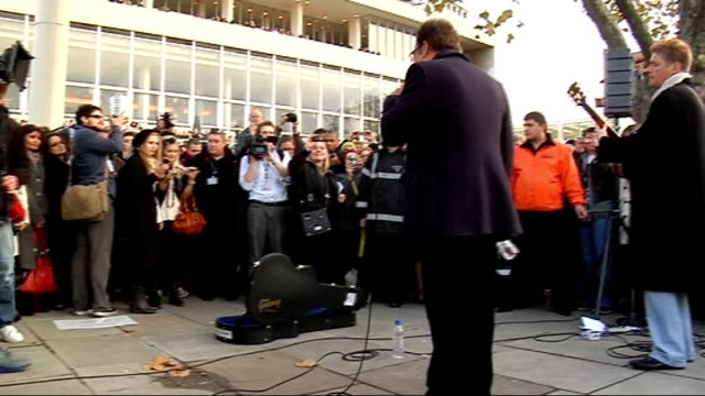 tom jones busks for charity audience / more of jones performing song sot / more of jones performing and audience watching sot / people watching from... - royal festival hall stock videos & royalty-free footage