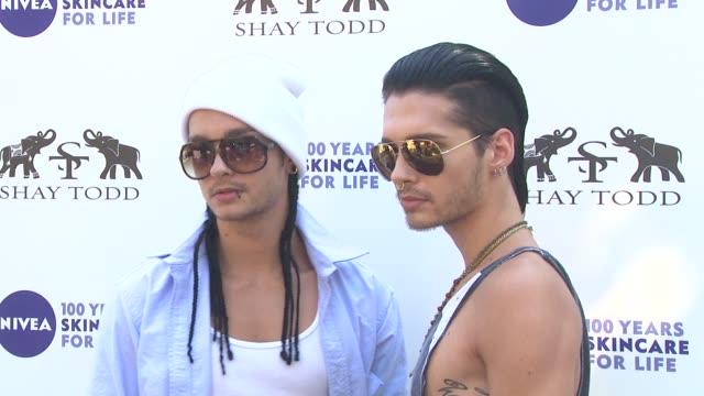 Tom Kaulitz and Bill Kaulitz of Tokio Hotel at the Khloe Kardashian Odom Reveals Results Of The 2011 NIVEA GoodBye Cellulite Hello Bikini Challenge...