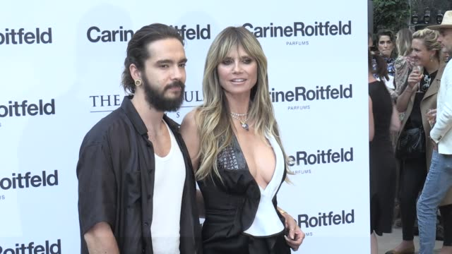 tom kaulitz and heidi klum pose for the photographers at the carine roitfeld parfums 7 lovers cocktail at the peninsula hotel in paris. monday, july... - heidi klum stock videos & royalty-free footage