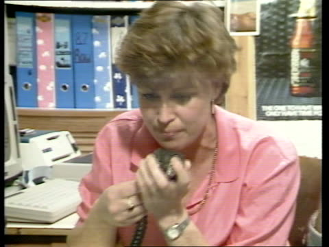 tom mcclean int coast cs jill mcclean listening to radio crackling cs side radio cms jill mcclean speaking into microphone of radio sof hello can you... - at the edge of stock videos and b-roll footage