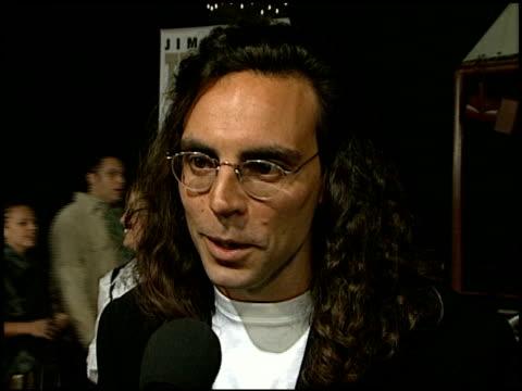 tom shadyac at the 'liar liar' premiere at universal amphitheatre in universal city, california on march 18, 1997. - ギブソンアンフィシアター点の映像素材/bロール