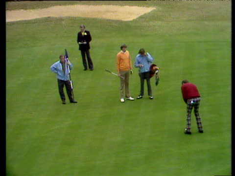 tom weiskopf holes his putt on 15th hole to leave peter oosterhuis putting to save match world matchplay championship semi final wentworth 1972 - pga world golf championship stock videos & royalty-free footage