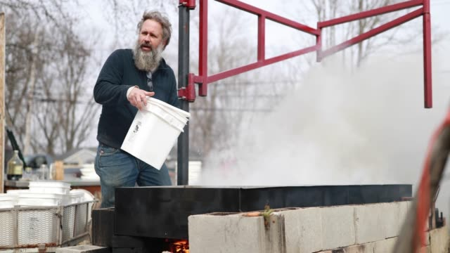 tom westgard pours maple tree sap into a stainless steel pan to make wood fired maple syrup at the knightridge farmstand sunday march 10 2019 weather... - metal blend stock videos and b-roll footage