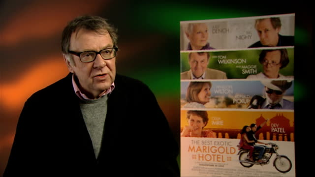 tom wilkinson on maggie smith at the best exotic marigold hotel interviews at soho hotel on february 28, 2012 in london, england. - トム ウィルキンソン点の映像素材/bロール