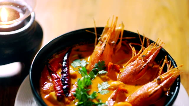 tom yum goong in a black bowl, seafood soup. - prawn seafood stock videos & royalty-free footage