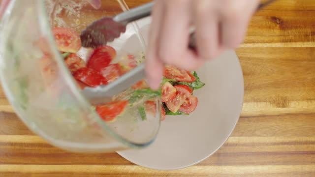 tomato basil salad with sliced mozzarella cheese - mozzarella stock videos & royalty-free footage