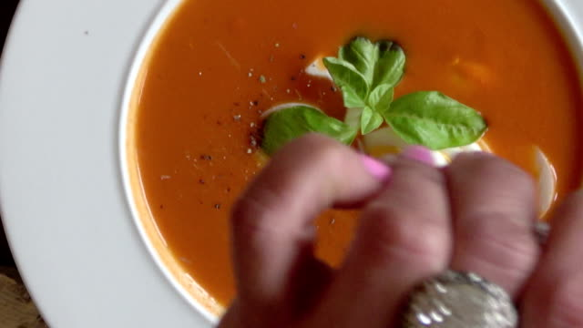 tomato bisque with boiled egg and basil garnish - tomato soup stock videos and b-roll footage