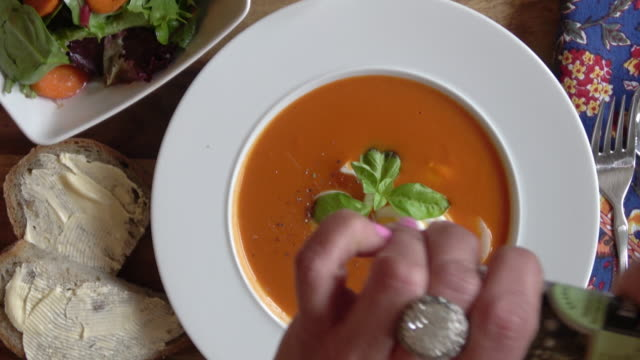 tomato bisque with boiled egg and basil garnish - soup stock videos & royalty-free footage