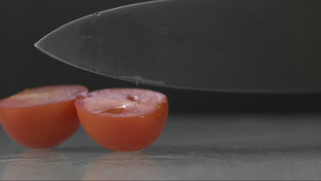 tomato cut with a kitchen knife V4