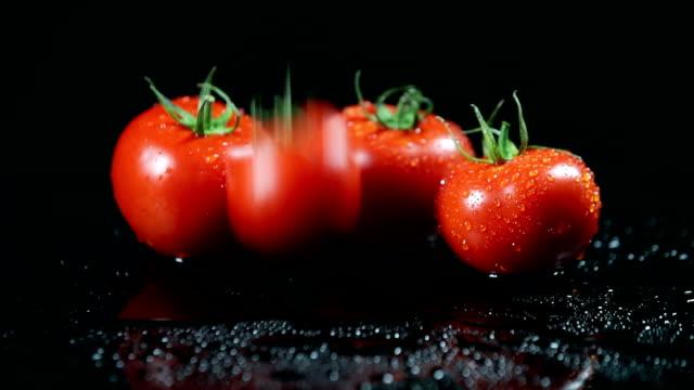 SLO MO Tomato landing on wet surface