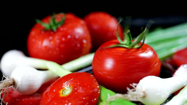 slo mo tomato rotating on wet surface and being splashed with water - raw food diet stock videos & royalty-free footage