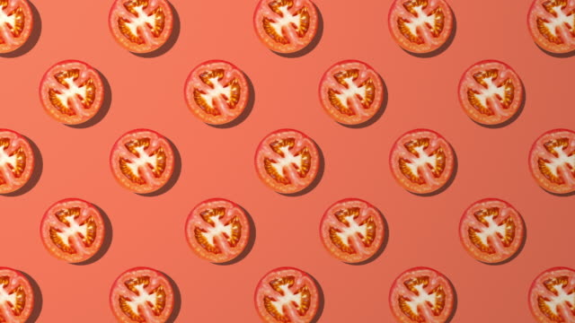 tomato slice spinning pattern on red background - studio shot stock videos & royalty-free footage
