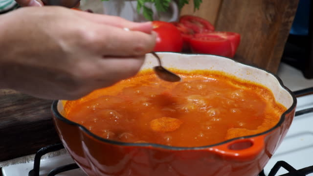 tomato soup - adding salt stock videos and b-roll footage