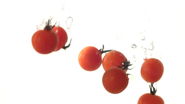 tomatoes falling into the water - medium group of objects stock videos & royalty-free footage