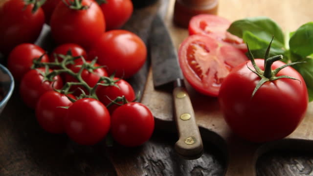 CU PAN Tomatoes on wooden rustic table / London, United Kingdom