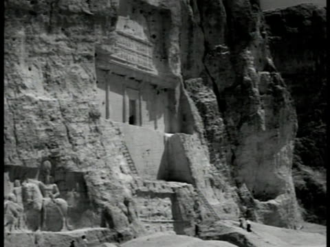 tomb of darius i of persia carved in cliff cross shape w/ center entrance cliff side carving shapur i on horseback w/ roman emperor valerian kneeling... - 1951 stock videos & royalty-free footage