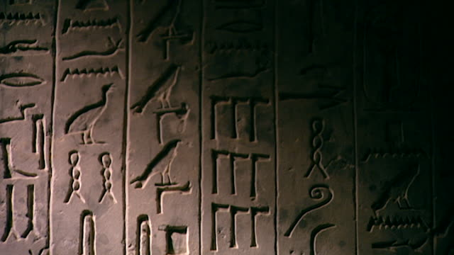 tomb of king teti. tilt-down of the hieroglyphs of the pyramid text that line the walls of king teti's burial chamber. - hieroglyph stock videos & royalty-free footage
