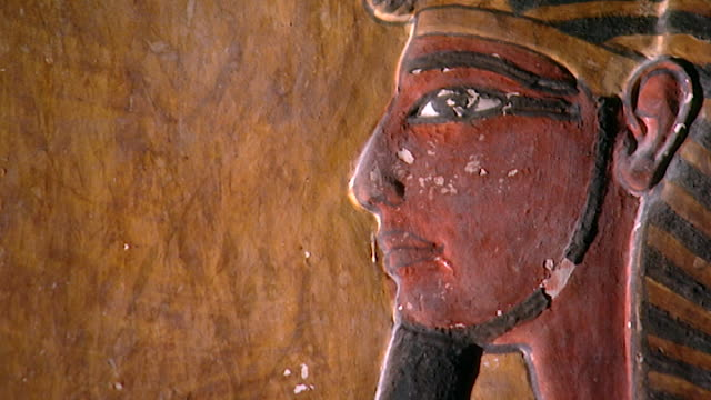 tomb of seti i. low-angle pan-left from wall painting of pharaoh seti i to the god osiris. - paintings stock videos & royalty-free footage