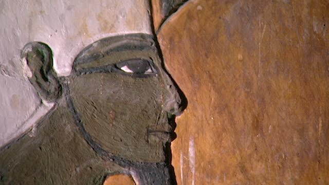 tomb of seti i. low-angle pan-right from wall painting of the god osiris to pharaoh seti i. - pharaoh stock videos & royalty-free footage