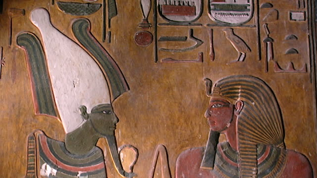 tomb of seti i. low-angle wall painting of pharaoh seti i opposite the god osiris wearing the atef crown. - paintings stock videos & royalty-free footage