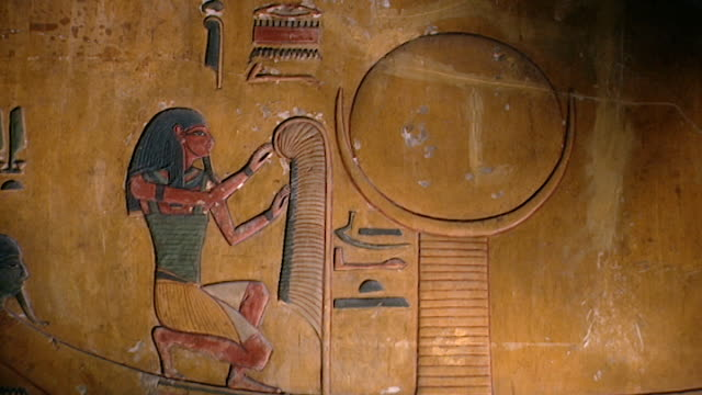 tomb of seti i. mcu painted bas-relief of a pharaoh in a boat on the nile river. - basrelief stock-videos und b-roll-filmmaterial