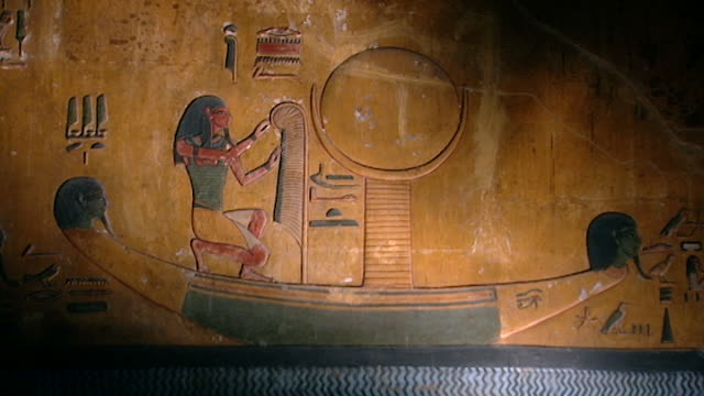 tomb of seti i. painted bas-relief of a pharaoh in a boat on the nile river. - basrelief stock-videos und b-roll-filmmaterial