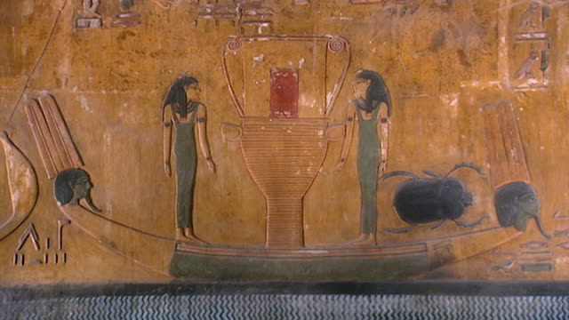 tomb of seti i. painted bas-relief of two women in a boat on the nile river. - basrelief stock-videos und b-roll-filmmaterial