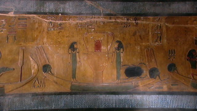 tomb of seti i. wide of painted bas-relief of two women in a boat on the nile river. - nautical vessel stock videos & royalty-free footage