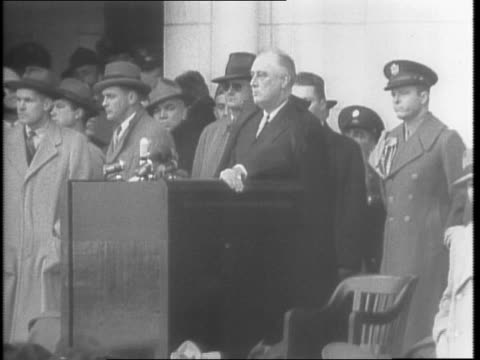 tomb of the unknown soldier wreath / closeup of general john j pershing and president franklin d roosevelt standing at attention / crowds / line of... - anno 1942 video stock e b–roll