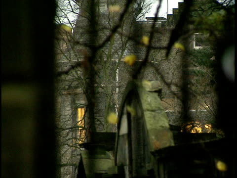 "cu, pan, r/f, tombs seen through iron gate entrance to greyfriars kirkyard, ""covenanters prison"" sign, edinburgh, scotland - 17th century style stock videos & royalty-free footage"