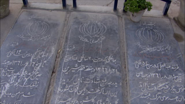 ms ha td tombstones at iraq war cemetery, esfahan, iran - tombstone stock videos and b-roll footage