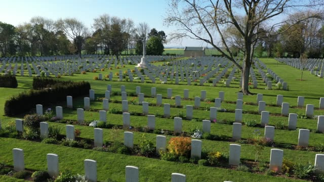 tombstones stand at the commonwealth war graves commission's benysurmer canadian war cemetery on april 30 2019 near reviers france june 6 will mark... - cemetery stock videos & royalty-free footage