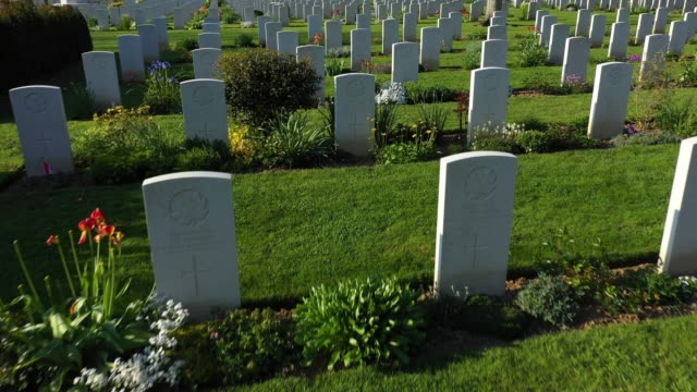 tombstones stand at the commonwealth war graves commission's beny-sur-mer canadian war cemetery on april 30, 2019 near reviers, france. june 6 will... - d day stock videos & royalty-free footage