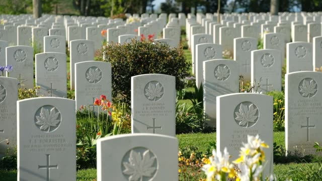 tombstones stand at the commonwealth war graves commission's benysurmer canadian war cemetery on april 30 2019 near reviers france june 6 will mark... - grab stock-videos und b-roll-filmmaterial