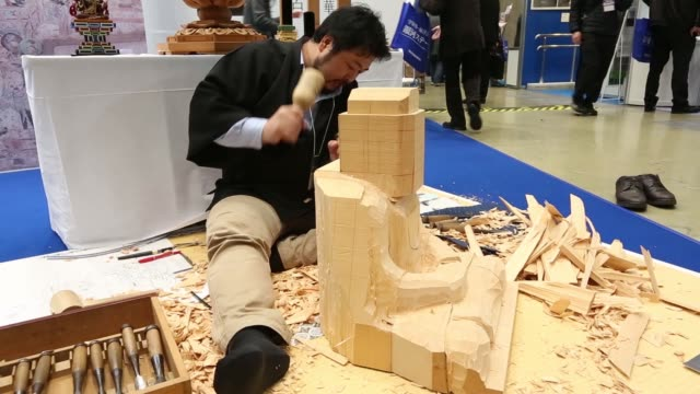 tombstones stand on display at a booth at the life ending industry expo in tokyo japan on tuesday dec 8 an exhibitor uses a hammer and a chisel to... - chisel stock videos and b-roll footage