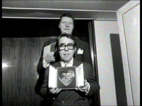 tommy cooper death tx savoy hotel ms cooper and ronnie corbett holding award 'top itv personalities' cms cooper with award tilt down corbett - ronnie corbett stock videos and b-roll footage