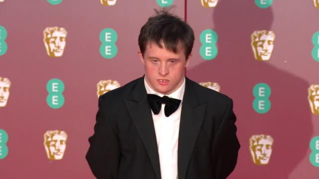 tommy jessop, actor, on red carpet at bafta film awards 2020 - formal stock videos & royalty-free footage