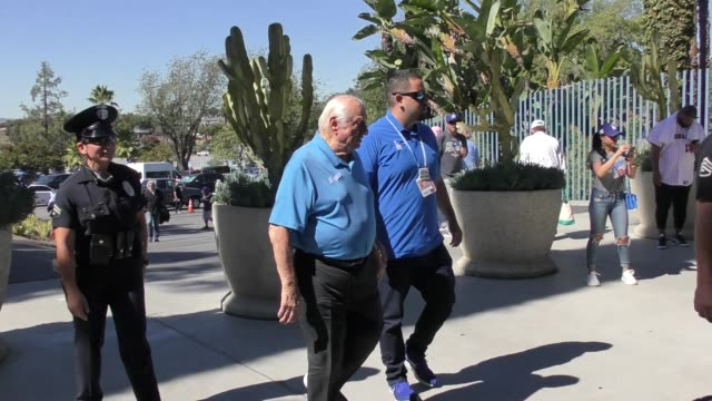 Tommy Lasorda waves to fans outside the Dodgers vs Brewers NLCS Game 5 Playoff at Dodger Stadium in Los Angeles in Celebrity Sightings in Los Angeles