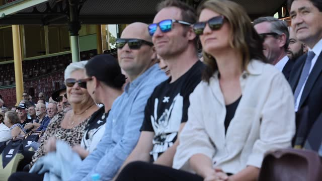 tommy raudonikis' wife trish brown along with family members watch the big screen tributes during the tommy raudonikis memorial service at the sydney... - australian national team stock videos & royalty-free footage