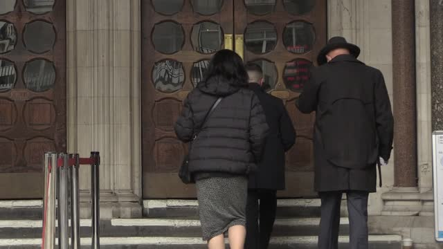 tommy robinson, the founder of the english defence league, returns to the royal courts of justice in central london for the libel case brought... - 創始者点の映像素材/bロール