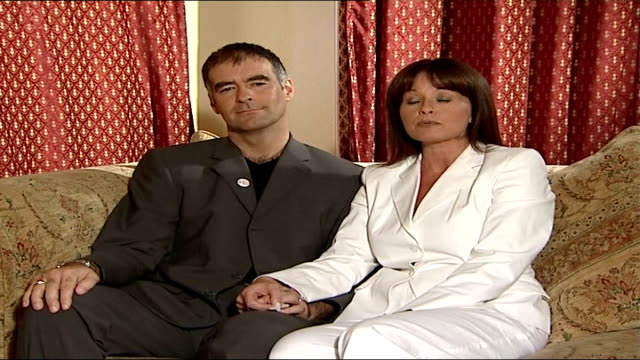 tommy sheridan and wife interview following successful libel action against news of the world; gail sheridan interview with tommy sheridan making... - 文書による名誉棄損点の映像素材/bロール