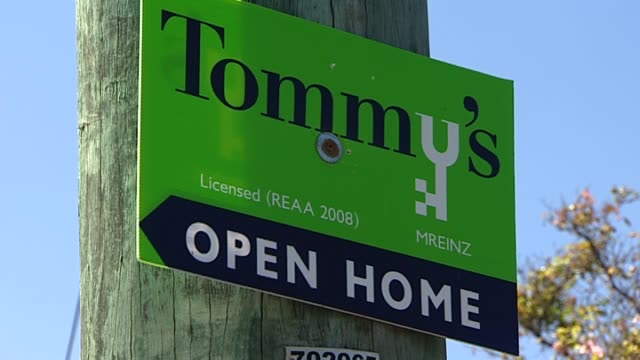 tommy's real estate sign on street pole outside property advertising house for sale and open home to be held - real estate sign stock videos & royalty-free footage