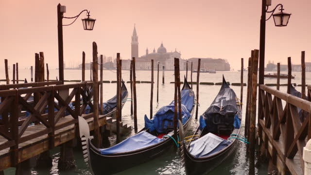 Toned image of gondolas in front of St. Marc's square, Italy